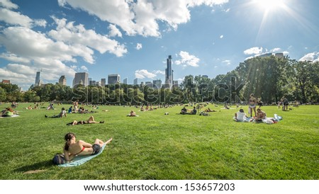 NEW YORK - SEPTEMBER 9: summertime in Central Park on September 9, 2013 in New York. Central Park is a public park at the center of Manhattan, which opened in 1857, on 778 acres of city-owned land. - stock photo