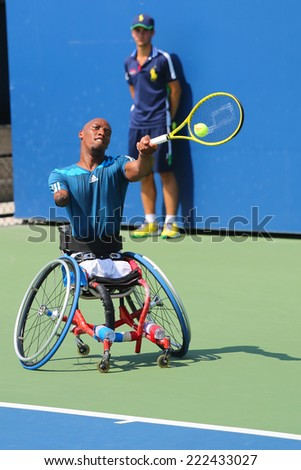 NEW YORK - SEPTEMBER 6 Tennis player Lucas Sithole from South Africa during US Open 2014 wheelchair quad singles match at Billie Jean King National Tennis Center on September 6, 2014 in New York  - stock photo