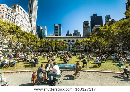 NEW YORK - September 24th: People enjoying a nice day in Bryant Park on September 24th, 2013 in New York City, NY. Bryant Park is a 9,603 acre privately managed park in the center of Manhattan. - stock photo