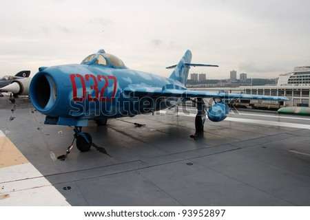NEW YORK - SEPTEMBER 24: This MiG-17, painted in the colors of the N. Vietnamese air force, shown on September 24, 2011, was built in Poland and is on the USS Intrepid Museum in New York City. - stock photo