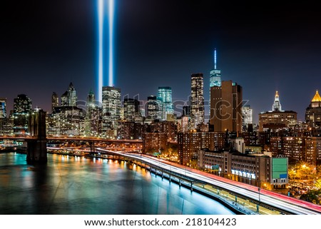 NEW YORK - SEPTEMBER 11, 2014: Tribute in Light memorial. The Tribute in Light is an art installation created out of two vertical columns of light in remembrance of the September 11 terrorist attacks. - stock photo
