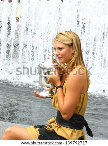 NEW YORK - SEPTEMBER 10: US Open 2006 champion Maria Sharapova holds US Open trophy after her win the ladies singles final  on September 10, 2006 in Flushing, New York - stock photo