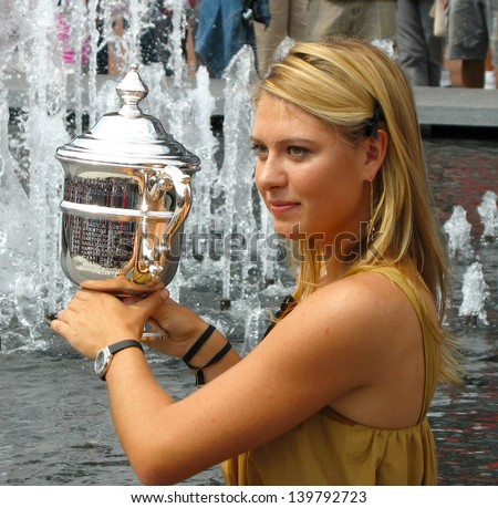NEW YORK - SEPTEMBER 10: US Open 2006 champion Maria Sharapova holds US Open trophy after her win the ladies singles final  on September 10, 2006 in Flushing, New York. - stock photo