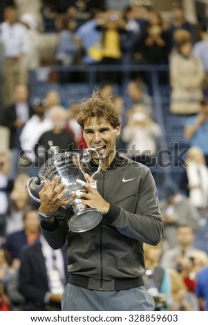NEW YORK - SEPTEMBER 9, 2013:US Open 2013 champion Rafael Nadal holding US Open trophy during trophy presentation after his final match win against Novak Djokovic at National Tennis Center in New York - stock photo