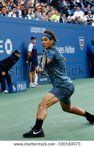 NEW YORK - SEPTEMBER 9: US Open 2013 champion Rafael Nadal of Spain in action during his final match against Novak Djokovic at Billie Jean King National Tennis Center in New York - stock photo