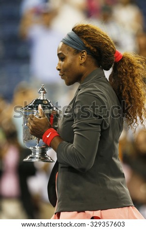 NEW YORK - SEPTEMBER 8, 2013:  US Open 2013 champion Serena Williams holding US Open trophy after win against Victoria Azarenka at Billie Jean King National Tennis Center  - stock photo