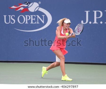 NEW YORK - SEPTEMBER 13, 2015: US Open 2015 junior girls champion Dalma Galfi of Hungary in action during final match at the Billie Jean King National Tennis Center - stock photo