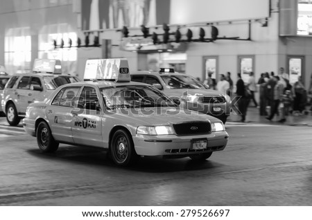 NEW YORK - SEPTEMBER 28, 2011: yellow cabs at area near Times Square at night. Times Square is a major commercial intersection and a neighborhood in Midtown Manhattan, New York City - stock photo
