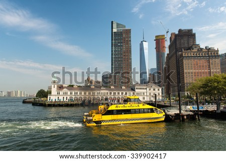 NEW YORK - SEPTEMBER 02: Yellow Water Taxi Tour Boat Docked at Pier Along Waterfront at New York City Boat Terminal, New York, USA. September 02, 2015. - stock photo