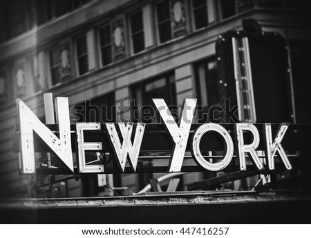 New York signage made from neon tubes with grunge filter in black and white - stock photo