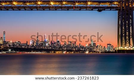 New York skyline at sunset framed by George Washington Bridge at dusk - stock photo