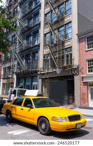 New York Soho buildings yellow cab taxi of Manhattan New York City NYC USA - stock photo