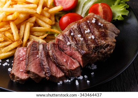 New York steak with french fries and salad, selective focus. - stock photo