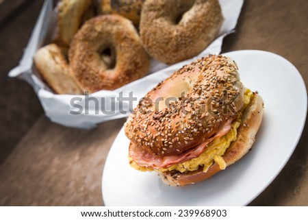 New York style breakfast bagel with scrambled eggs and ham - stock photo