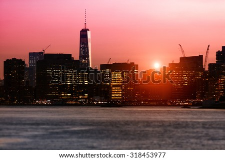 New York sunset over the East River with One World Trade Center - stock photo