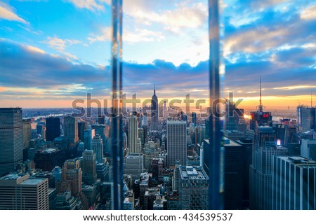 NEW YORK, UNITED STATES - DECEMBER 30, 2015 - A View of the Manhattan Skyline at Twilight seen through the glass of a window - stock photo