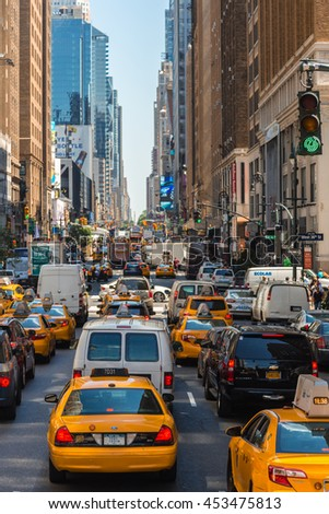 NEW YORK, UNITED STATES - JUN 22, 2016: Taxi in heavy traffic on the streets of New York. View from above. - stock photo