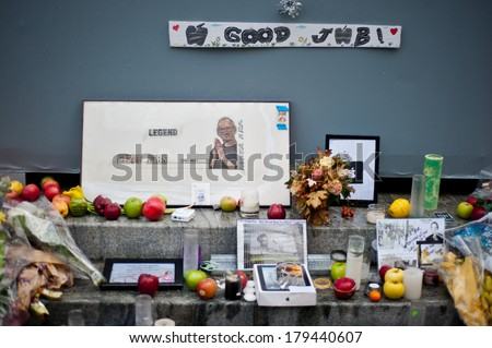 NEW YORK, UNITED STATES OF AMERICA - OCTOBER 14, 2011 : Shrine to Steve Jobs near the enter to New York Apple central store on October 14, 2011. Former CEO of Apple died on October 05,  2011. - stock photo