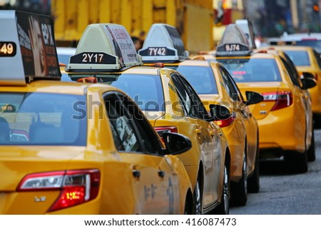 New York, US - August 28, 2015: yellow taxi cab in Chelsea distrct New York - stock photo