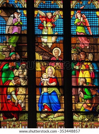 NEW YORK, US - SEPTEMBER 14, 2012: Stained Glass window depicting a Nativity Scene at Christmas in St. Patrick's Cathedral in New York City. - stock photo