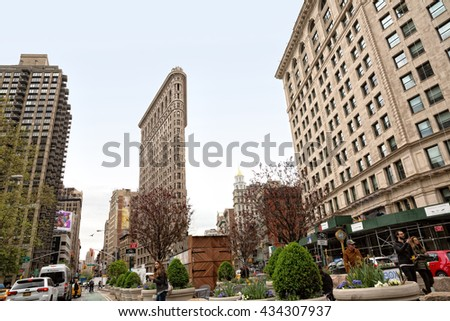 NEW YORK, USA - Apr 27, 2016: Flatiron Building at NYC. Originally the Fuller Building, is a triangular steel-framed landmarked building located at  175 Fifth Avenue in the borough of Manhattan - stock photo