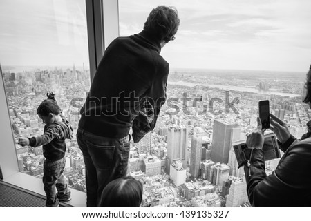 NEW YORK, USA - Apr 28, 2016: People in One World Observatory. This observation deck is located at the top of One World Trade Center, the tallest building in New York City. - stock photo