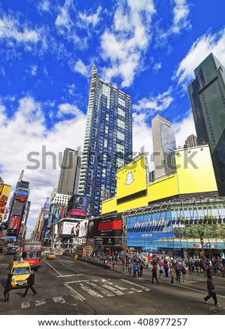 New York, USA - April 24, 2015: Crowded with tourists Broadway and 7th Avenue in Times Square. Skyscrapers in Midtown Manhattan in New York, USA - stock photo