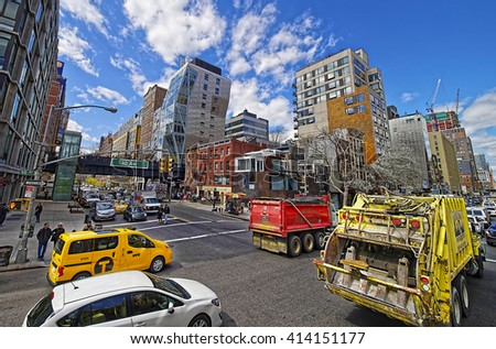 New York, USA - April 24, 2015: Intersection of 10th Avenue and West 23rd Street with a view to High Line Park in Downtown Manhattan, New York City, USA. Tourists in the street - stock photo