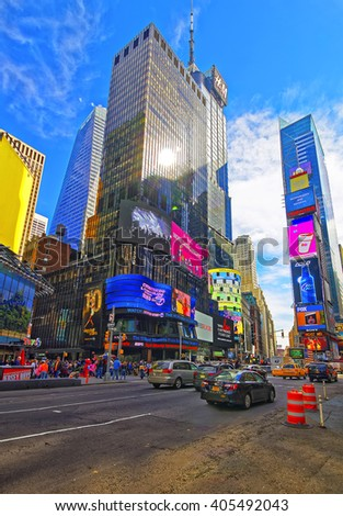 NEW YORK, USA - APRIL 25, 2015: Intersection of 7th Avenue and West 44th Street and Broadway in Midtown, Manhattan, New York, USA. Tourists around - stock photo