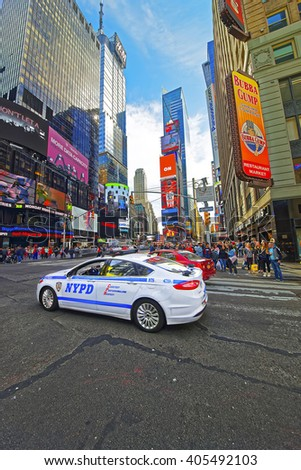 NEW YORK, USA - APRIL 25, 2015: Intersection of 7th Avenue and West 44th Street and Broadway in Midtown Manhattan, New York, USA. It is Times Square. Tourists around - stock photo