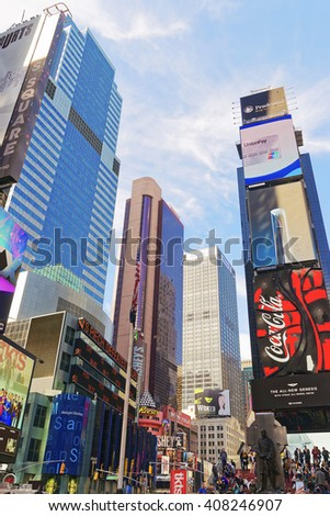 New York, USA - April 26, 2015: Pedestrian part of Broadway and 7th Avenue on Times Square. Skyscrapers in Midtown Manhattan in New York, USA. It is a commercial junction of Broadway and 7th Avenue. - stock photo