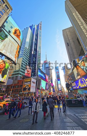 New York, USA - April 25, 2015: Pedestrians  in Times Square on 7th Avenue and Broadway. Skyscrapers in Midtown Manhattan in New York, USA. It is a commercial junction of Broadway and 7th Avenue. - stock photo