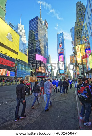 New York, USA - April 25, 2015: Pedestrians on Broadway and 7th Avenue in Times Square. Skyscrapers in Midtown Manhattan in New York, USA. It is a commercial junction of Broadway and 7th Avenue. - stock photo
