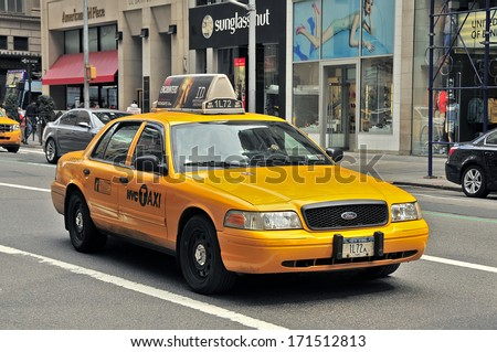 NEW YORK, USA - APRIL 11: Taxi in the traffic, Manhattan, April 11, 2012 in New York City. The city is planning to replace its fleet of various kinds of taxis with one model. - stock photo