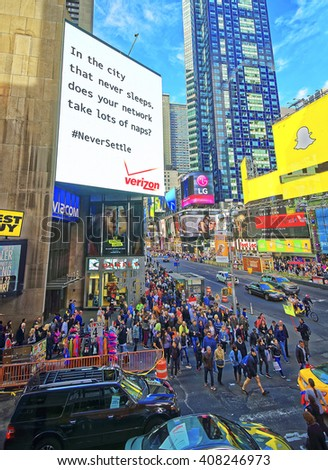 New York, USA - April 25, 2015: Tourists crossing street in Times Square in New York. Skyscrapers in Midtown Manhattan in New York, USA.  - stock photo