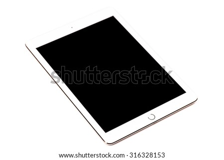 New York, USA - August 21, 2015:Brand new Gold White Apple iPad Air 2, 6th generation of the iPad, developed by Apple inc. and was released on October 16, 2014 - stock photo