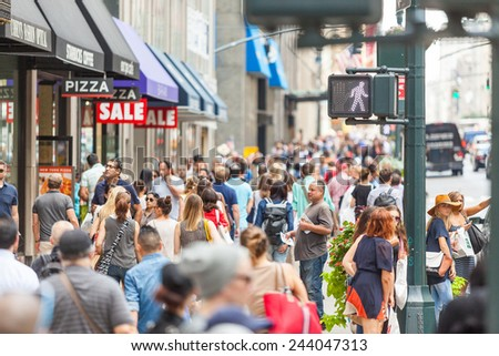 NEW YORK, USA - AUGUST 28, 2014: Crowded sidewalk on 5th Avenue with tourists and commuters on a sunny day. - stock photo