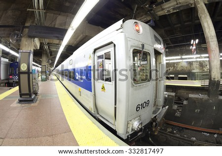 New York, USA - August 15, 2015: Fisheye lens photo of MTA train at the Grand Central Terminal. The MTA is North America's largest transportation network with 8856 rail and subway cars. - stock photo