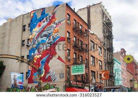 NEW YORK,USA - AUGUST 21,2015 : Graffiti of the Statue of Liberty at historic Little Italy in New York - stock photo