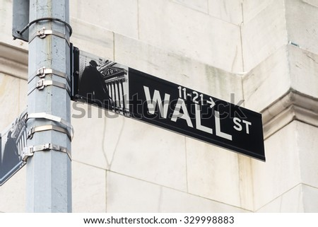 NEW YORK,USA - AUGUST 14,2015 : Street sign at Wall Street in Manhattan Financial District in New York City - stock photo