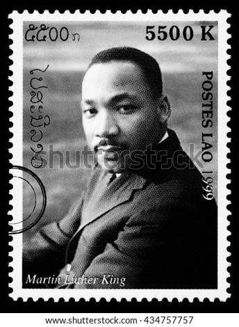 NEW YORK, USA - CIRCA 2010: A postage stamp printed in Laos showing Martin Luther King, circa 1999 - stock photo