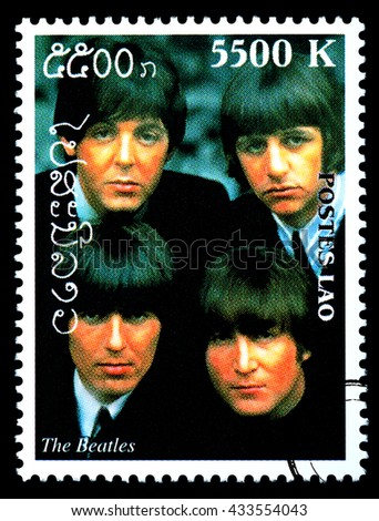 NEW YORK, USA - CIRCA 2010: A postage stamp printed in Laos showing The Beatles; circa 2000 - stock photo