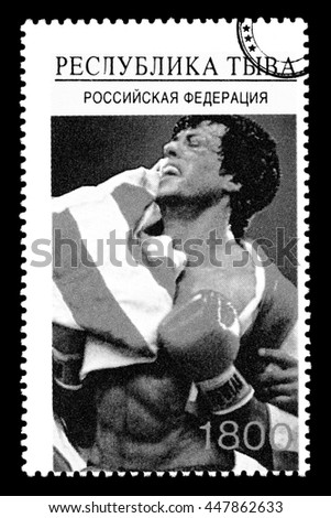 New York, USA - CIRCA 2010: A postage stamp printed in Russia showing Hollywood movie star Sylvester Stallone wrapped in an American flag shot during the Rocky movie, circa 2005 - stock photo