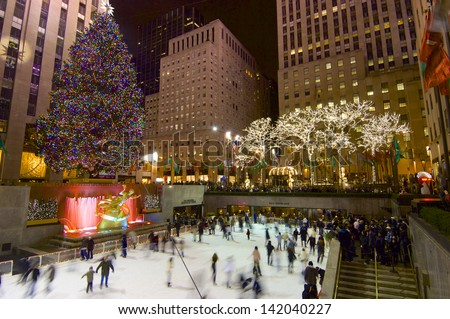 NEW YORK, USA - JANUARY 2: skate on January 2, 2008 in New York: tourists and skaters in the famous Rockefeller Center during the Christmas holidays. - stock photo