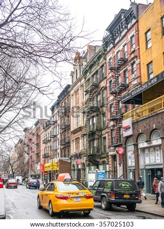 NEW YORK, USA - January 3, 2015: Streets of the East Village in New York in a cloudy winter morning. New York City has a population of more than 19 million. - stock photo