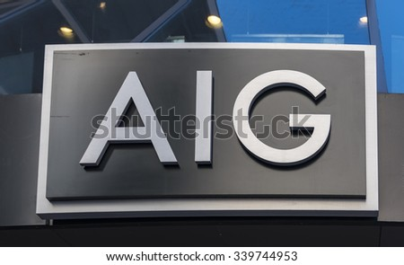 NEW YORK,USA-JULY 3,2015:AIG or American International Group signage. AIG is an American multinational insurance corporation with operations in 130 countries across the world. - stock photo