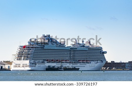 NEW YORK,USA-JULY 3,2015:New York Cruise liners: Multi-storied cruise ship off the New York coast.Tourists have a variety of packages to choose from, for enjoying the cruise trips  is one option - stock photo