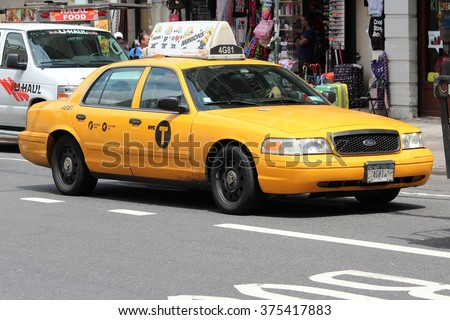 NEW YORK, USA - JULY 2, 2013: People ride yellow taxi in Manhattan in New York. As of 2012 there were 13,237 yellow taxi cabs registered in New York City. - stock photo