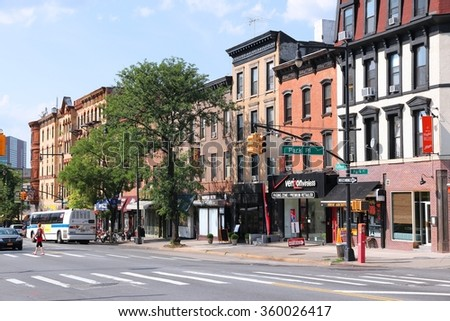 NEW YORK, USA - JULY 6, 2013: People walk in Prospect Heights, Brooklyn. New York City is visited by 56 million annual visitors (2014). 20 million people live in NY metropolitan area. - stock photo