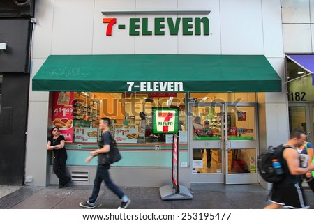 NEW YORK, USA - JULY 3, 2013: People walk past 7-Eleven convenience store in New York. 7-Eleven is world's largest operator, franchisor and licensor of convenience stores, with more than 46,000 shops. - stock photo